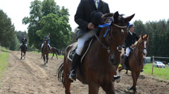 Horse riders winners with awards trophy cups leave hippodrome Stock Footage