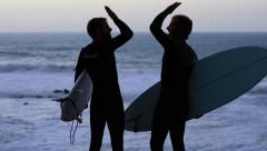 2014 atlantik surfer sundown highfive2 - stock footage