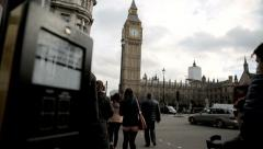 Pedestrians parliament square and westminster Stock Footage