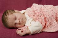Stock Photo of young baby sleeping, studio picture