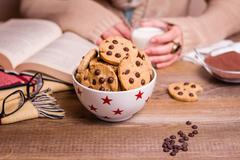 Chocolate chip cookies on stars bowl over a table Stock Photos