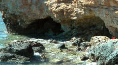 Europe Spain Balearic Ibiza coves and landscapes 134 small caves in a cliff Stock Footage