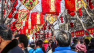 Stock Video Footage of Crowded visitors at temple fair in Ditan Park during Chinese Spring Festival