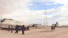 Children play at Zaatari Refugee Camp Stock Footage