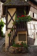 street with half-timbered medieval houses in eguisheim village along the famo - stock photo