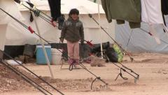 Girl plays cord in Zaatari Refugee Camp Stock Footage