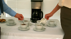Business people making coffee in the staff room Stock Footage