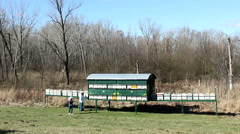 Stock Video Footage of Beekeeping, Bees And Hives ,bees in apiary,beehive,Beekeeper