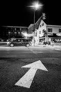 Stock Photo of arrow on pavement and intersection at night in hanover, pennsylvania.