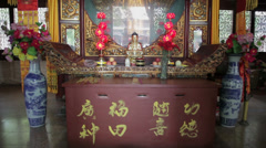 Gold Buddha Statue in chinese temple Stock Footage