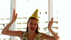 Pretty girl in party hat jumping Stock Footage