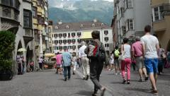 People walking through Innsbruck with its golden roof. Stock Footage