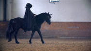 Stock Video Footage of Someone Under Black Robe Riding Black Horse