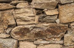 Dry masonry stone wall closeup - stock photo