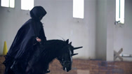 Stock Video Footage of Slow Motion Black Robe Riding Black Horse With Horn