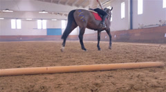Young Jockey Girl Training in Big Bright Hall Stock Footage