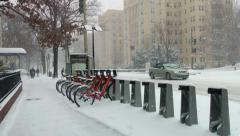 Bike share bicycles in snow storm Stock Footage