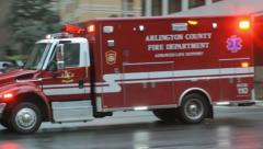 ALS Ambulance approaches, passes, siren, horn, urban. Stock Footage