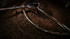 Mixing roasted coffee n014 - stock footage
