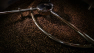 Stock Video Footage of Mixing roasted coffee n014