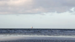 Distant gas drilling rig in Liverpool Bay Stock Footage