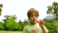 Stock Video Footage of Little boy blowing bubbles