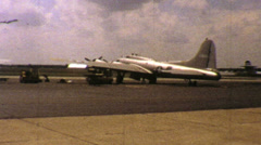Old Military Aircraft Sits At Airport-1972 Vintage 8mm film Stock Footage