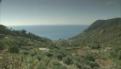Pan of the hills and countryside in Monterosso along the coast to the sea Stock Footage