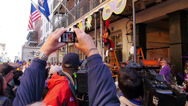 Stock Video Footage of People Watch the Greasing of the Poles Festival at Mardi Gras 4085