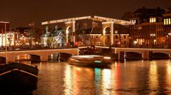 4K UHD Skinny Bridge Amsterdam, Holland, night, time lapse Stock Footage