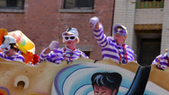 Stock Video Footage of Throwing Beads from a Mardi Gras Parade Float 4105