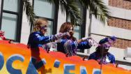 Stock Video Footage of Throwing Beads from a Float in a Mardi Gras Parade 4100