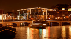 Skinny Bridge Amsterdam, Holland, night, time lapse Stock Footage