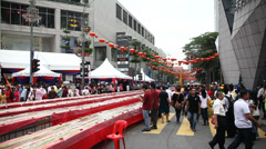People waiting to start Malaysian festival Stock Footage