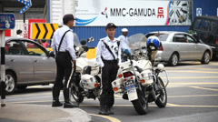 Traffic Police on Malaysia roads Stock Footage