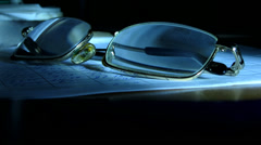 Glasses in the weak artificial light Stock Footage