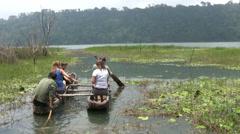 Traditional dugout canoe (Pedau) in Tamblingan lake, Bali Stock Footage