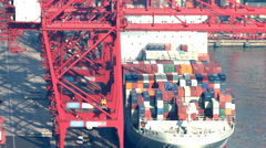 Timelapse video of a cargo ship loading in a cargo port Stock Footage
