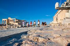 The Erechtheion and tourists on Acropolis of Athens. Greece. - stock photo