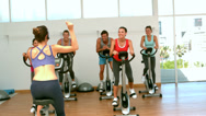 Stock Video Footage of Spin class working out with instructor