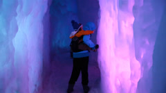 Mother and baby in ice castle Stock Footage