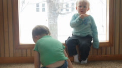 Three year old pretends to breakdance Stock Footage