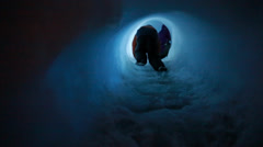 Kid in ice tunnel Stock Footage
