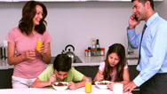 Stock Video Footage of Family having breakfast together in kitchen