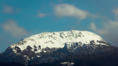 Clouds over snowy mountain peak extreme telephoto timelapse - stock footage