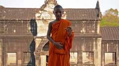 Cambodian monk in angkor wat temple Stock Footage