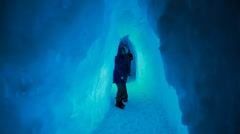 Couple walking in an ice cave Stock Footage