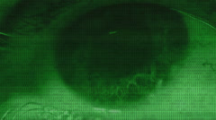 Dense binary code overlay on a close up of the human eye Stock Footage