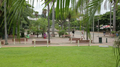 Pan of coconut square and local people, noumea, new caledonia Stock Footage