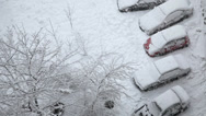 Stock Video Footage of snowcarSnow covered cars at the parking lot and snowfall